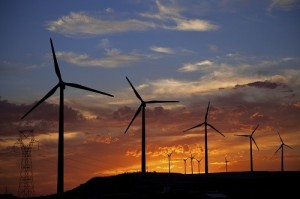 Wind turbines at a burning sunset