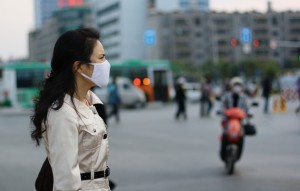 Woman wearing a face mask, China