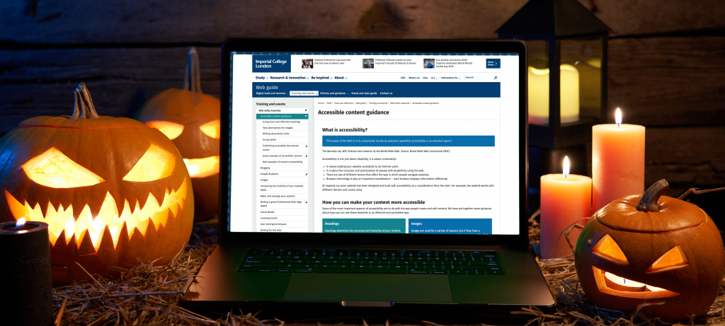 Three lit halloween pumpkins and candles next to a laptop showing the Imperial accessibility website