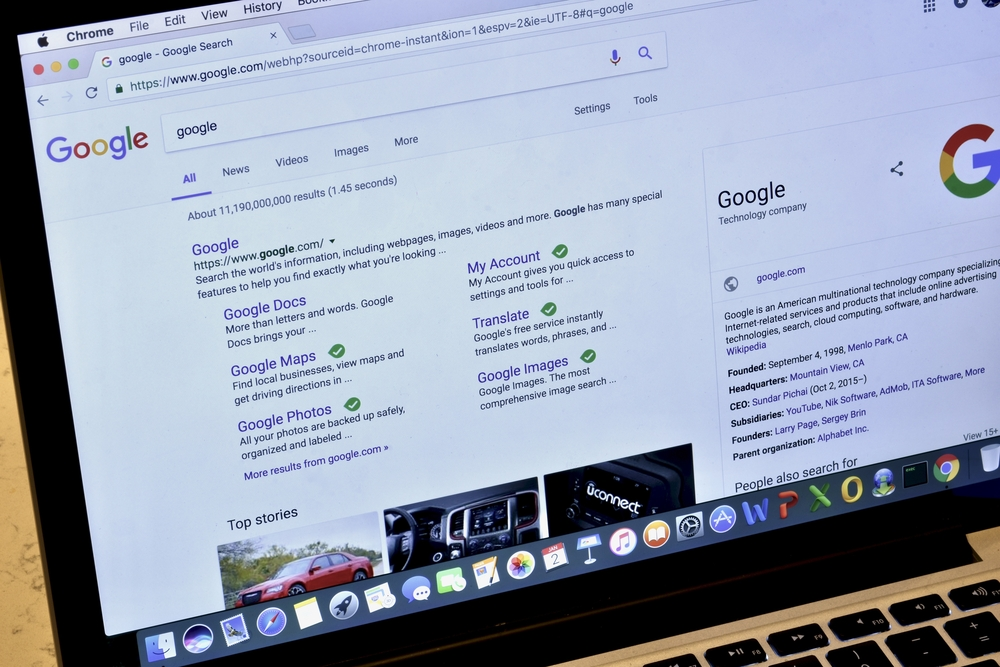 Photograph of a laptop showing Google search results