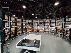 A room with a semi-circular arrangement of mounts for monitors