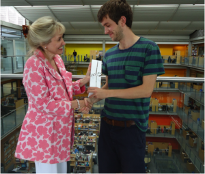 Professor Jenny Higham, Director of Education,  presents the first prize to Ben Foster