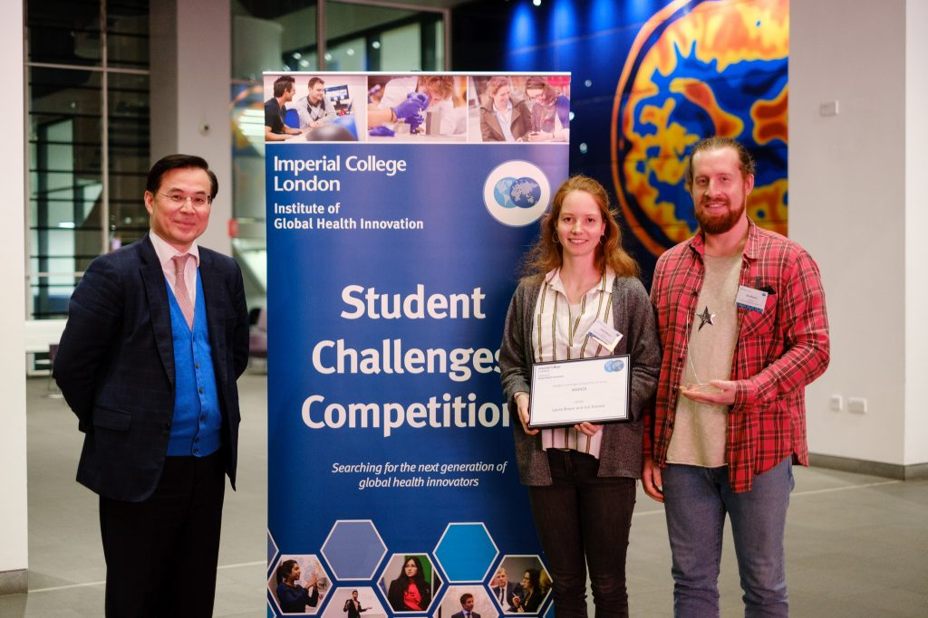 Laura and Kai being awarded first prize at IGHI's Student Challenges Competition.