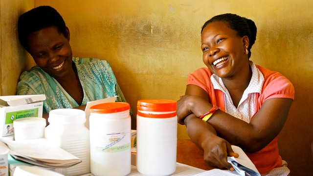 Two female nurses laughing and smiling.