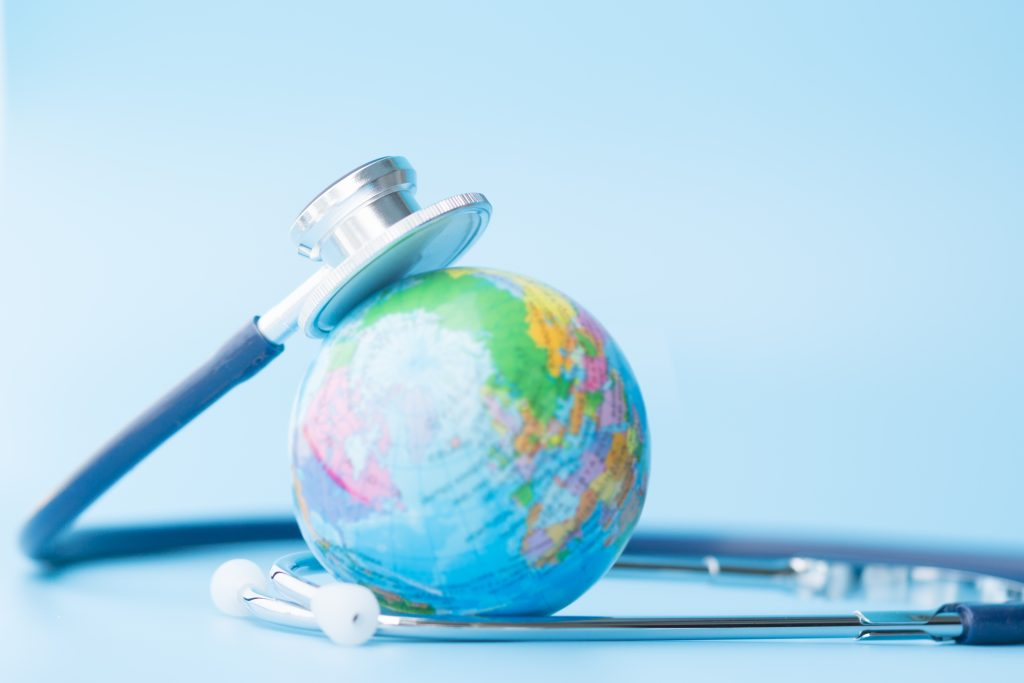A globe surrounded by a stethoscope.