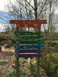 A signpost about a garden at a children's hospice