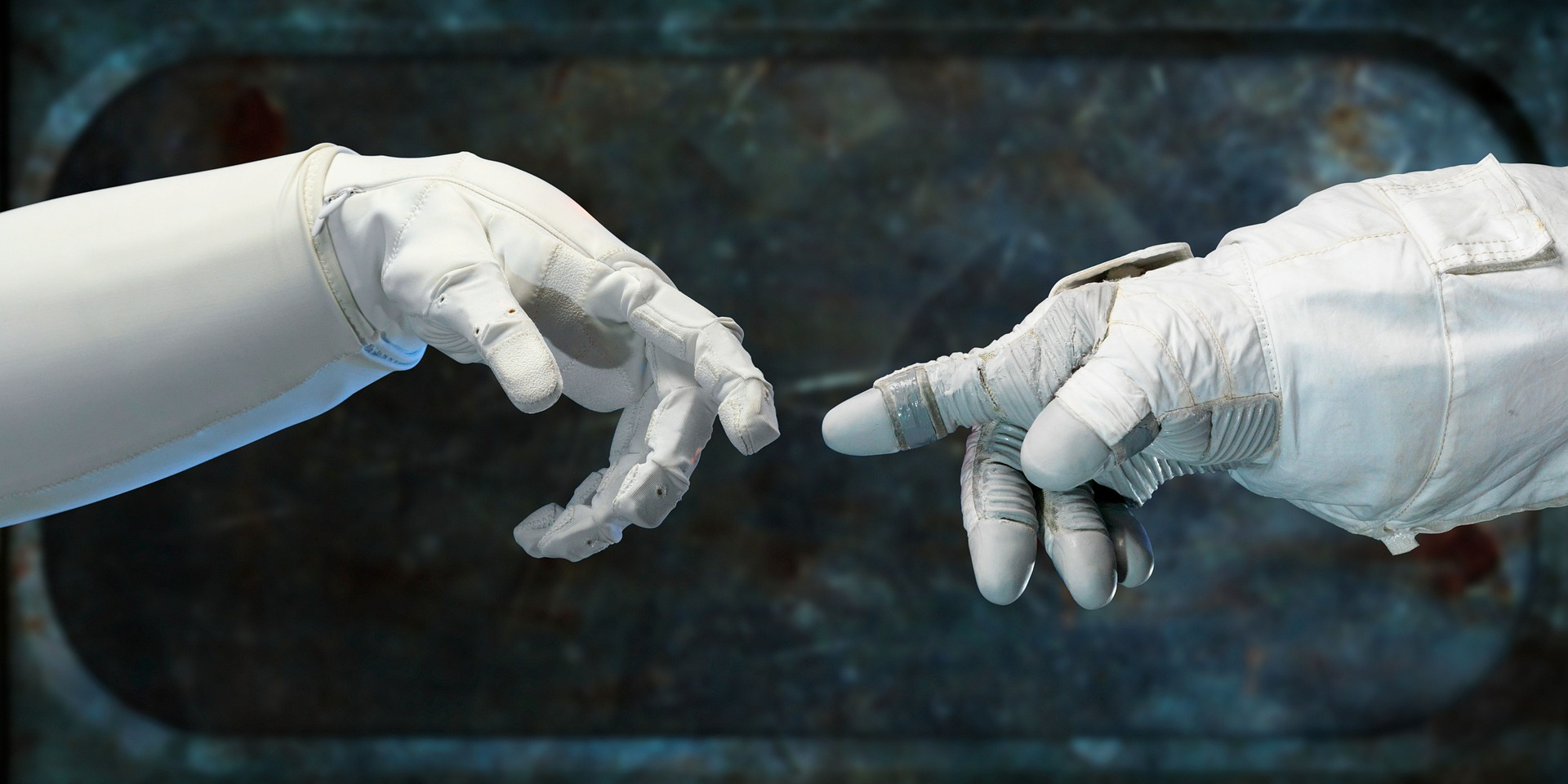 An image of a robot's finger touching an astronaut's finger in space