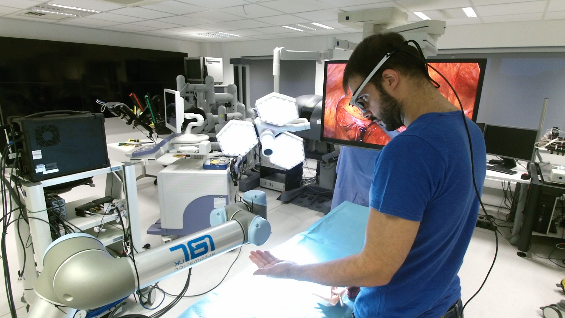 A man with a robot in a laboratory