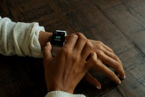 A person using a smartwatch with the OnTrack app