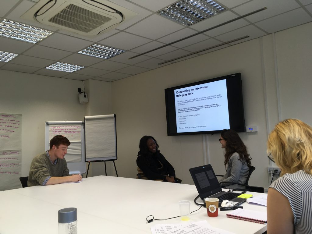 The co-researchers doing interview training