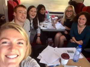 The co-production team on a train