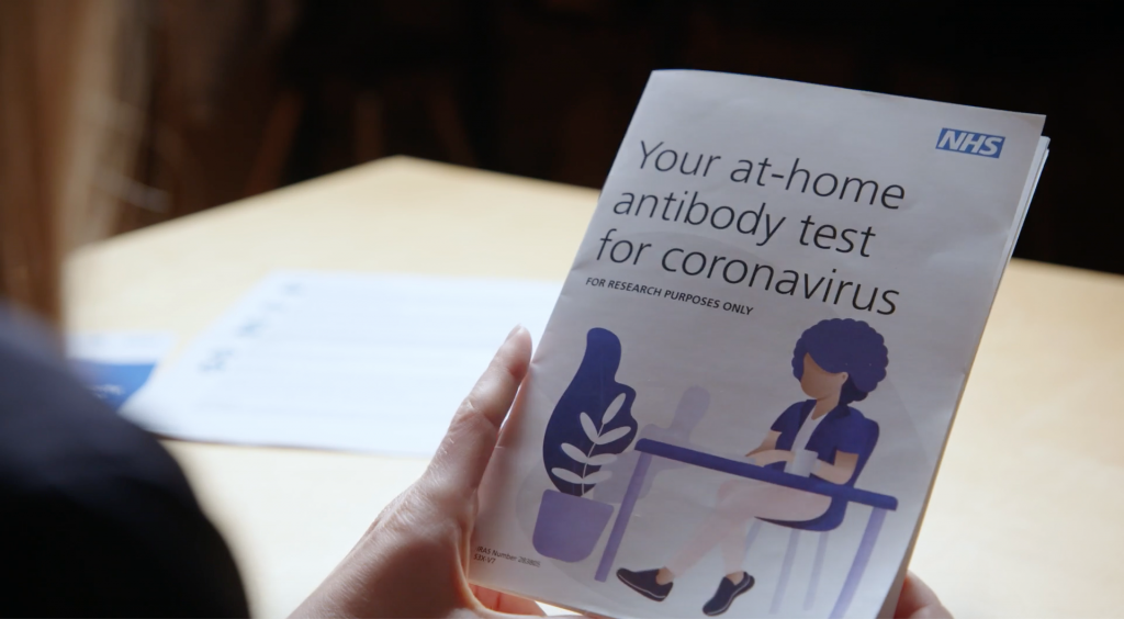 A person reading an antibody test instruction manual