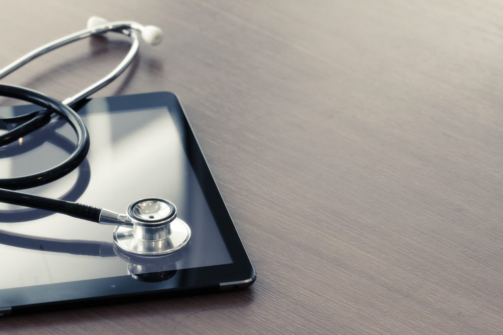 An ipad and stethoscope representing digital health technology