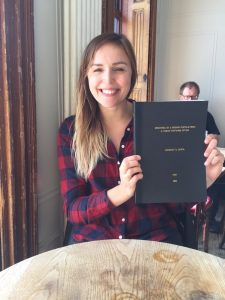 Mental health researcher Lindsay with a book