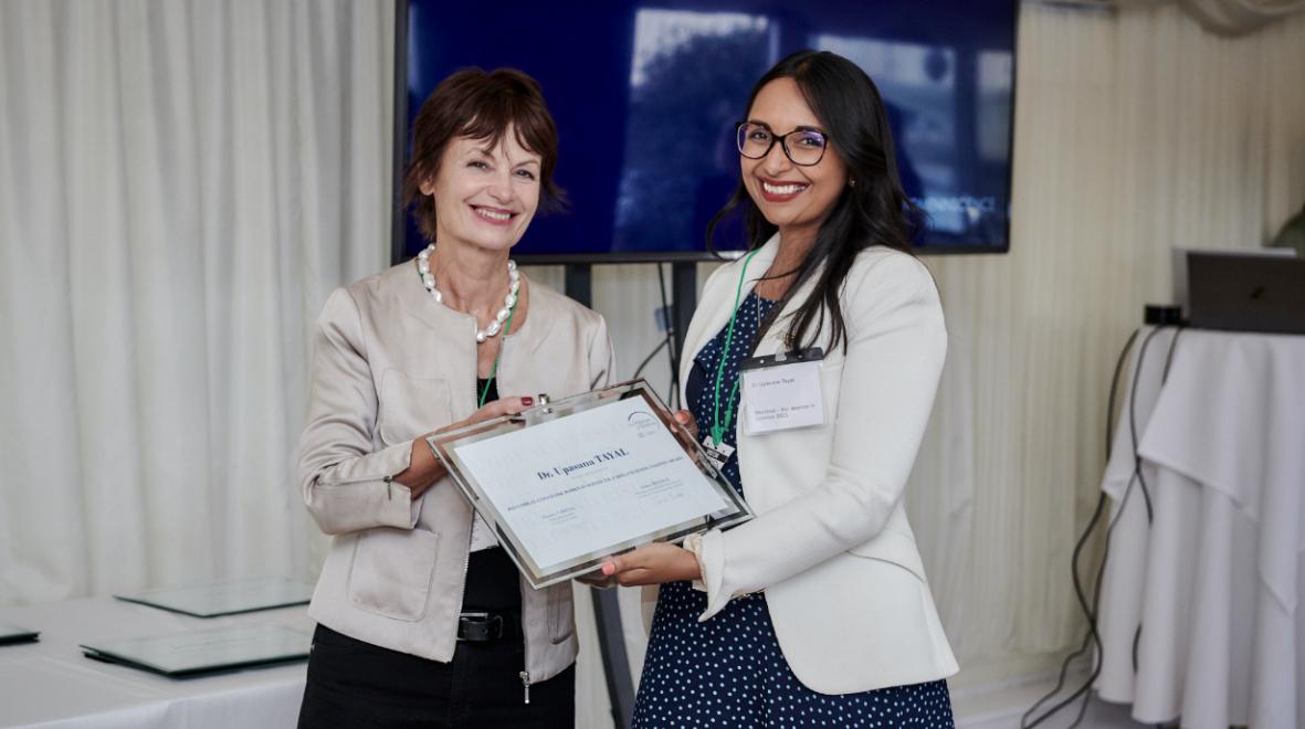 Paz Tayal receiving award