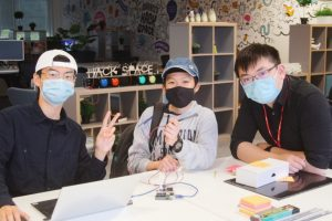 The three members of team Turbidimeter in the Hackspace working on their project