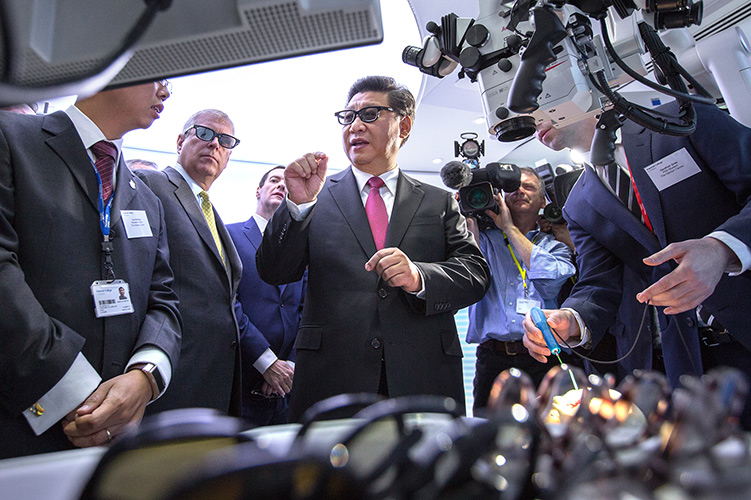 President Xi Jinping at a demonstration of robotic instruments.