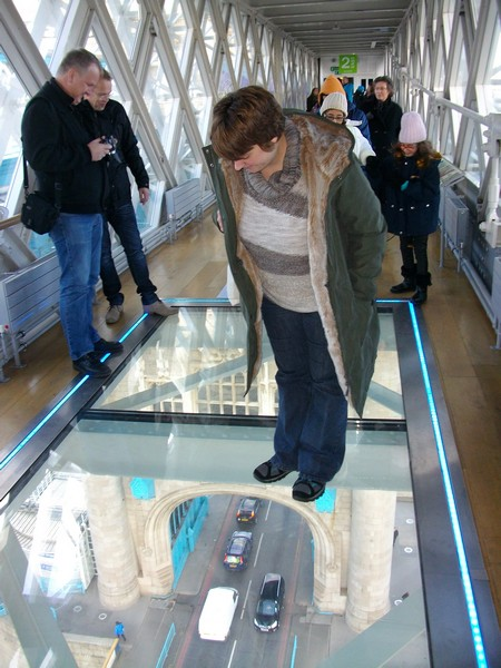 Looking down on the River Thames from the Tower Bridge glass floor.