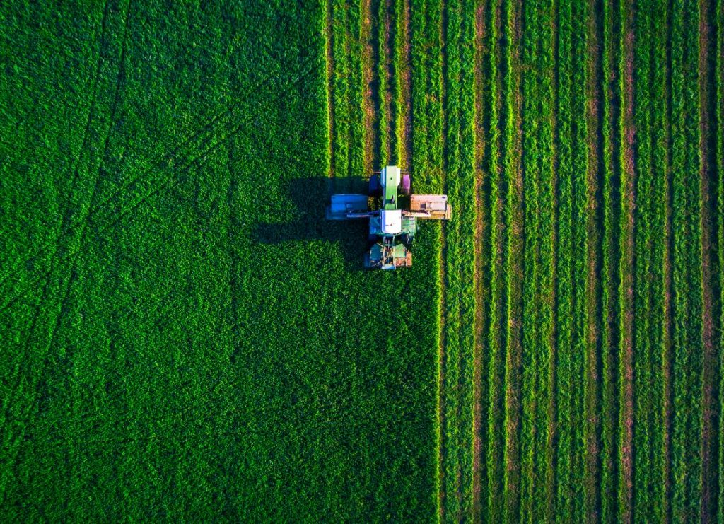 Aerial photo of a tractor ploughing a field